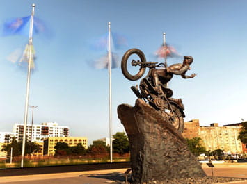 Statue of a motorcycle climbing a hill