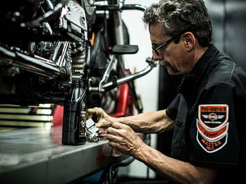 Service technician working on a motorcycle