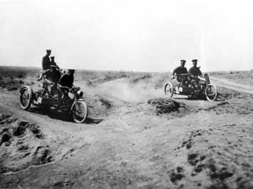 People riding vintage Harley-Davidson motorcycles